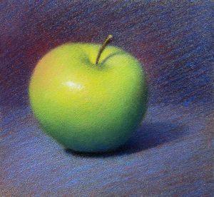 Bâton de pastel sur la pomme.