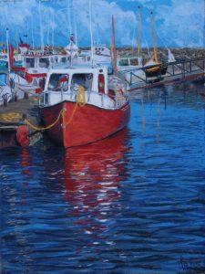 Bateau rouge amarré au quai.